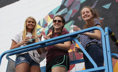 Students from Billings Central Catholic High School work on their mural at 2650 4th Ave North.